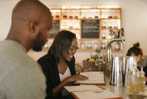 couple reading menu | Nucific