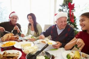 family enjoying holiday dinner | Nucific