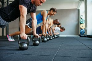 group of people working with kettle bells