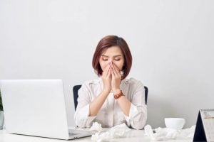 sick woman at work | Nucific