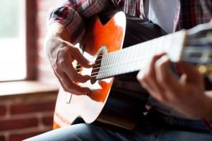playing guitar | Nucific